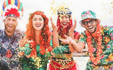 Happy dressed people celebrating at carnival party throwing confetti - Young friends having fun together at fest event - Youth, hangout, festive and happiness concept - Focus on left couple hands , #AD, #confetti, #throwing, #Young, #fun, #friends #Ad