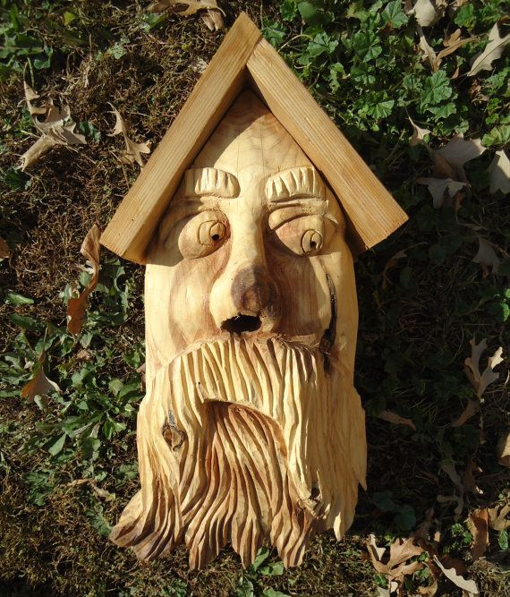 Hand carved birdhouse with an original face, all made with ...Old Man Face Bird Houses