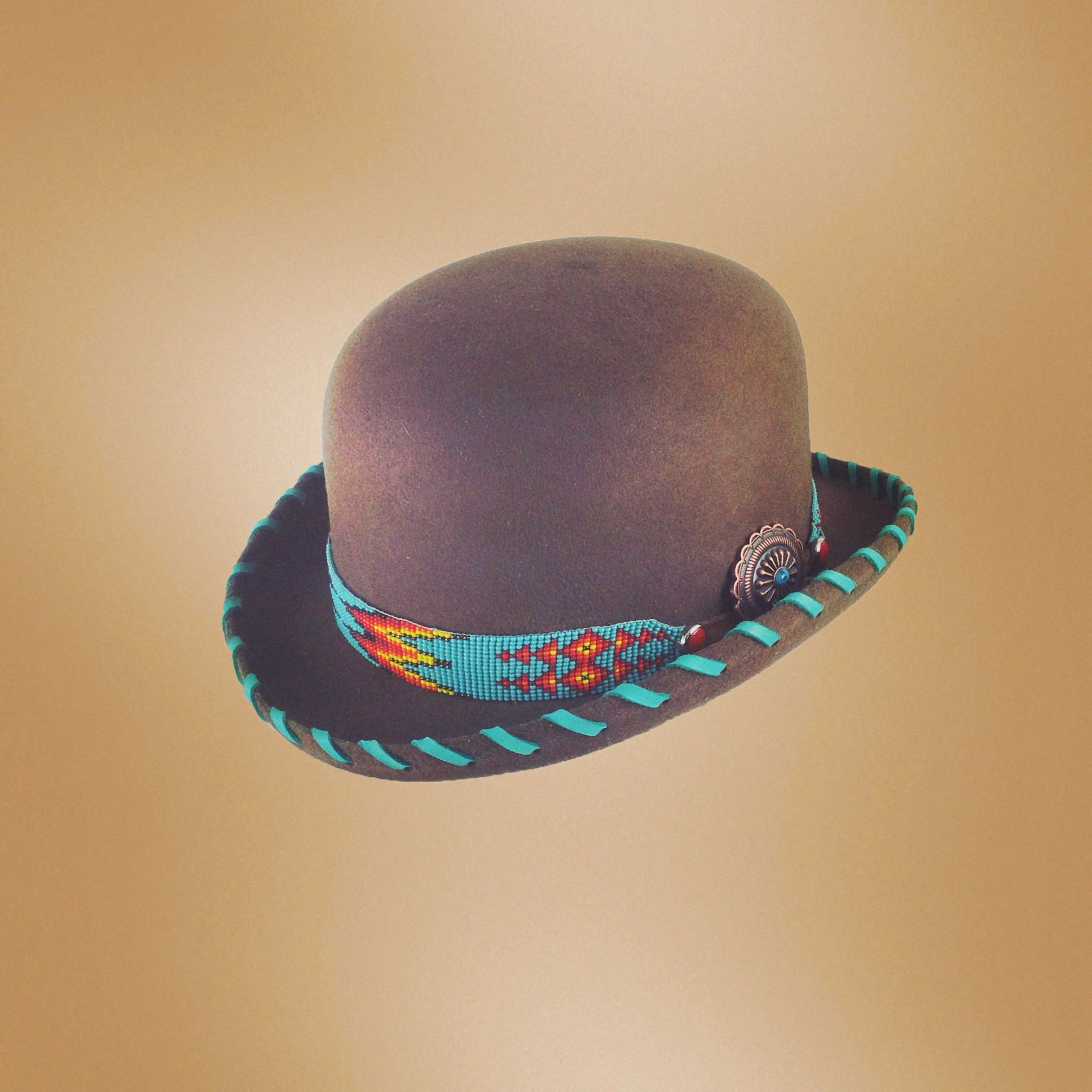 80bca966 Brown felt bowler hat with beaded hatband and deerskin lacing - Red Star  Riggings