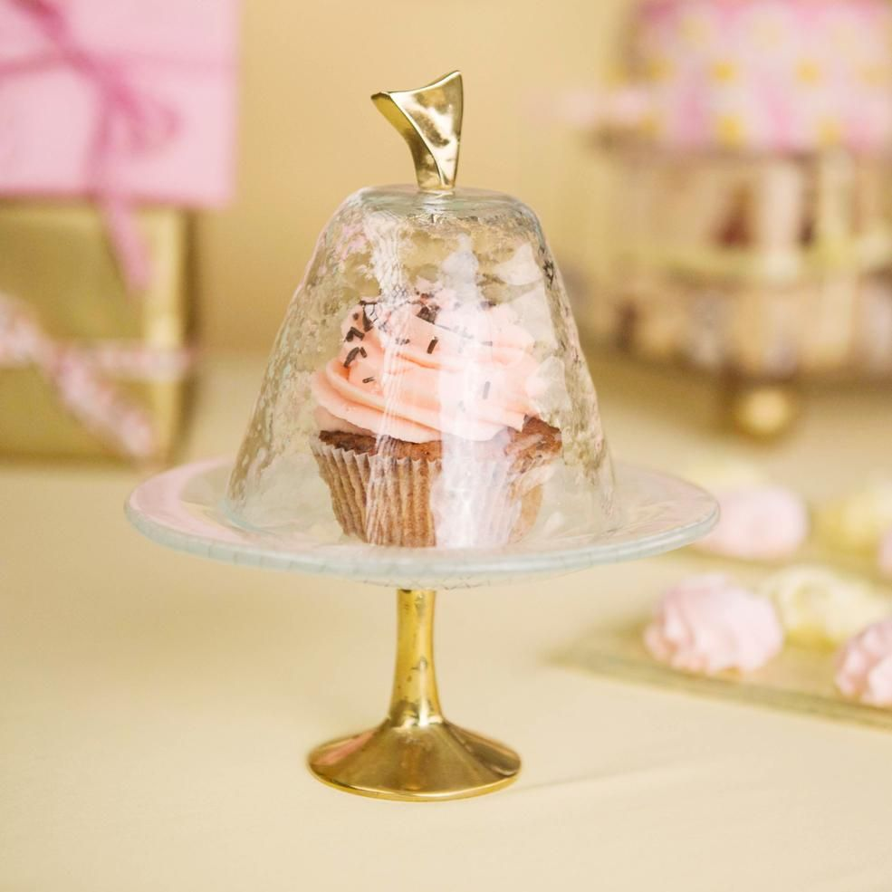 pink cake stand with dome