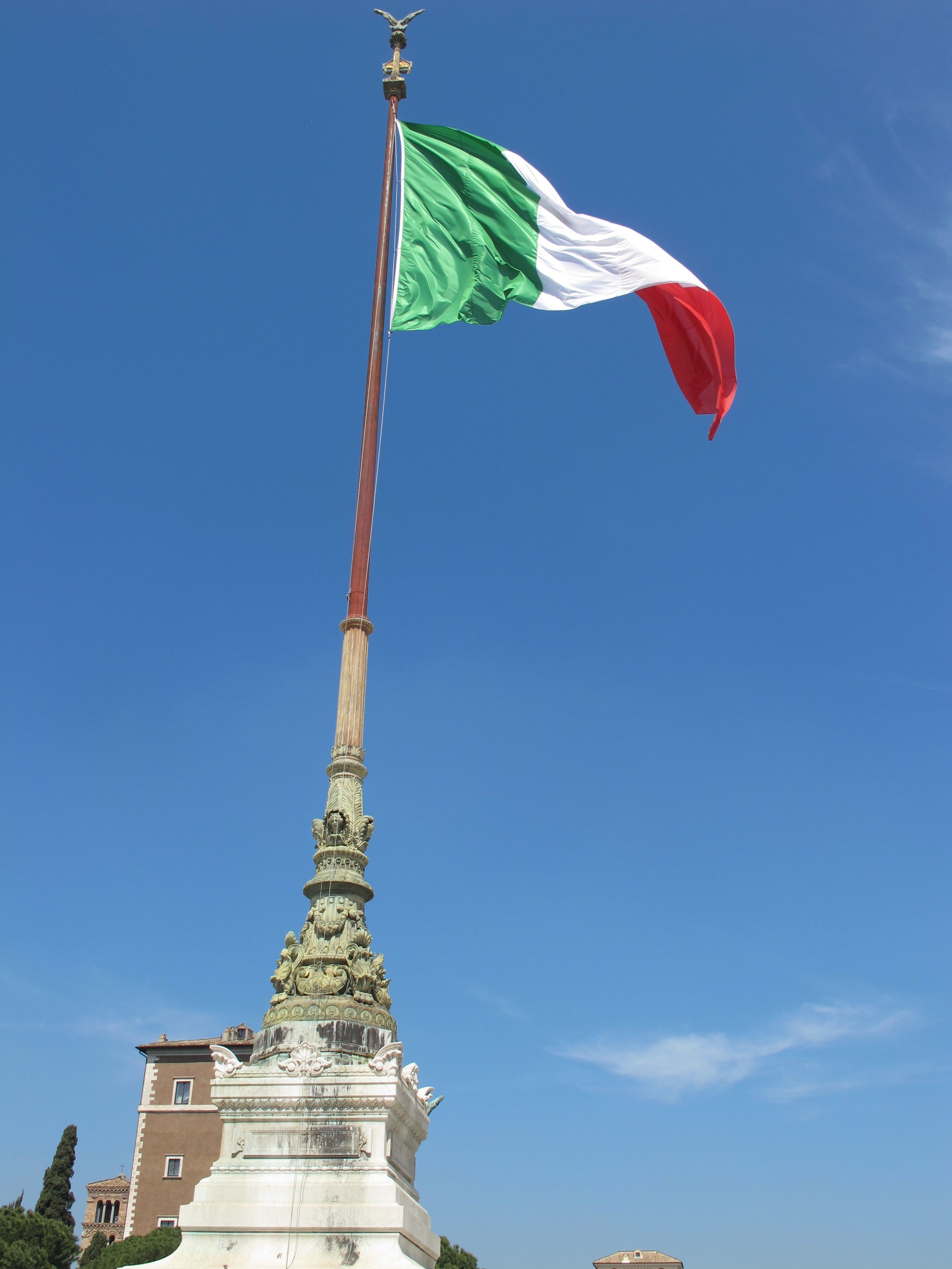 The Italian Flag Flies Over The Vittoriano Pink And Purple Flowers Purple Flowers Eiffel Tower
