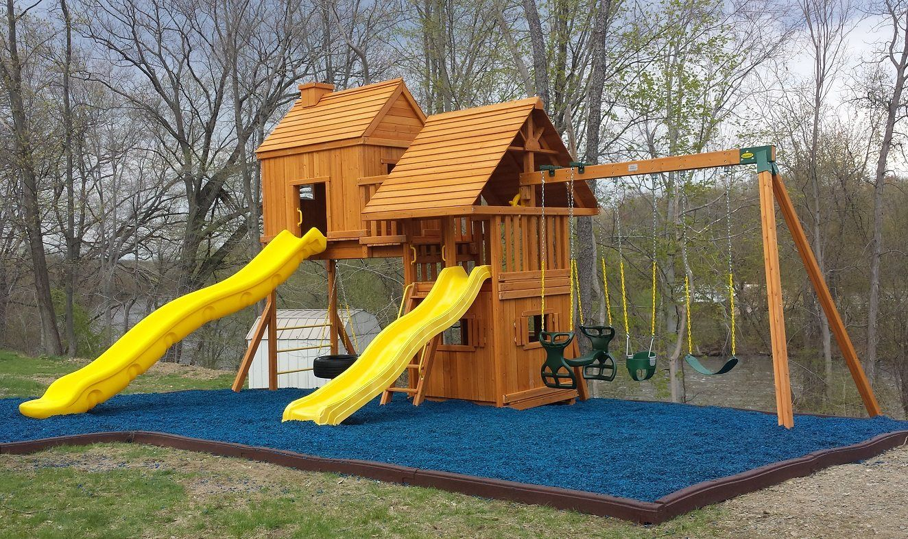 blue rubber mulch looks great against cedar swing sets especially the ones with yellow