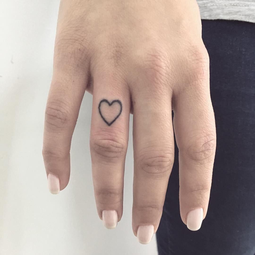 Small Heart Tattoo By Gianina Caputo Inked On The Right Hand S Ring Finger Small Heart Tattoos Heart Tattoo Tattoos