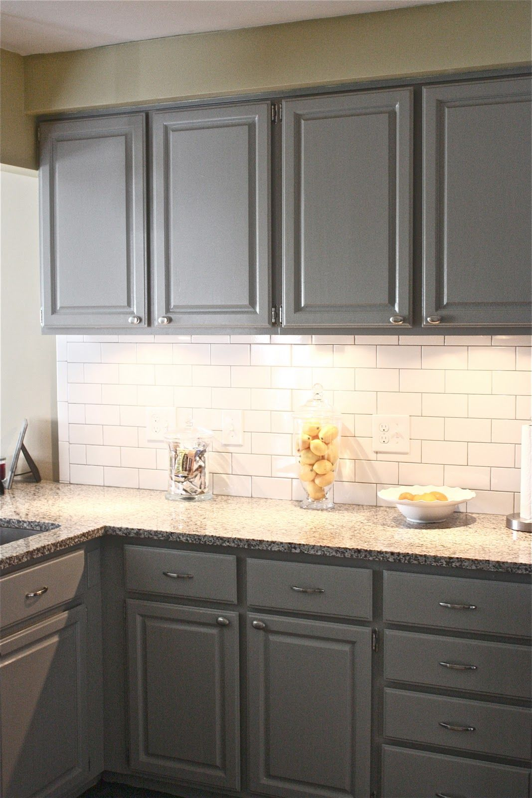 Painted Gray Kitchen Cabinets Single Handle Faucet With Sprayer White Corian Countertops Tile Floor