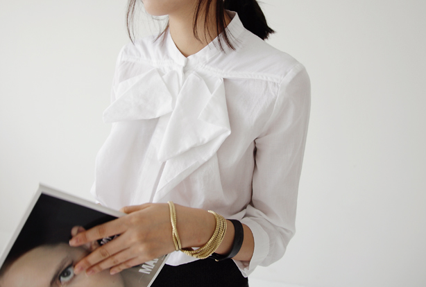 Layer on your favorite bracelets with a tailored white shirt