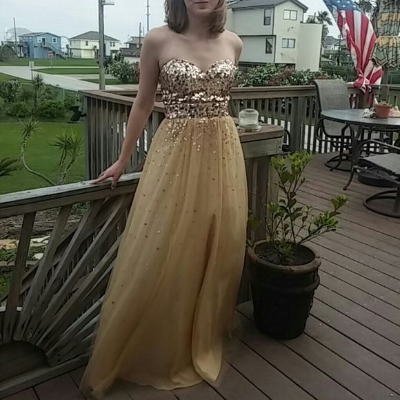 Gold Floor-Length Strapless Prom Dress This is a beautiful gold and cream prom dress with gold spangles stitched in. Only worn once! I loved it!!! Dresses