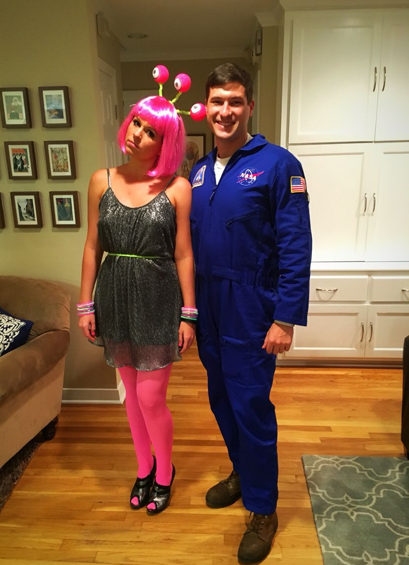 Halloween couples costume. Astronaut meets alien ...