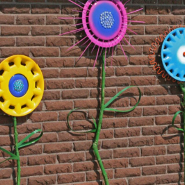 Abandoned hubcaps turned into painted porch flowers. :)