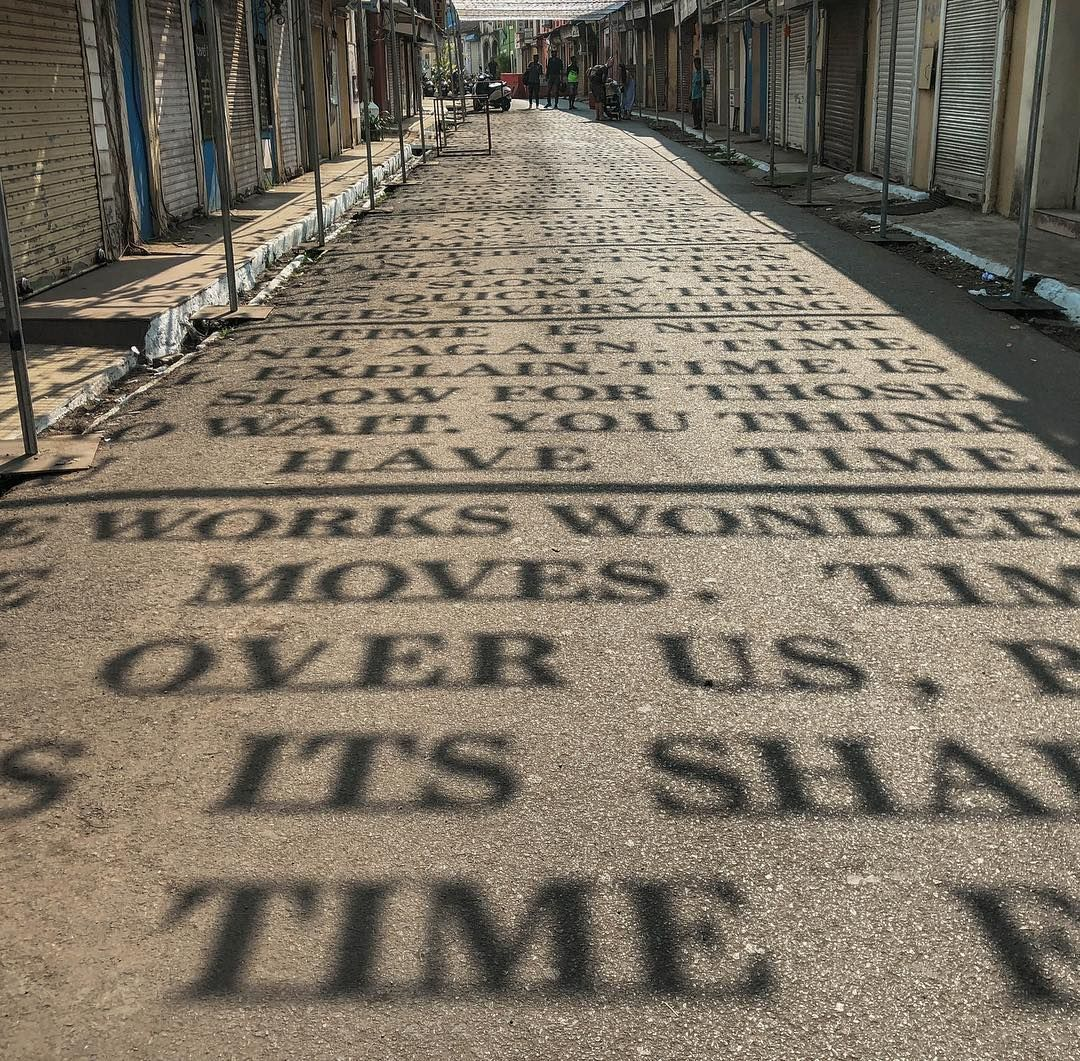 Sunlight Casts Shadows of Phrases Exploring Theories of Time in a Street Art Installation by DAKU #artinstallation