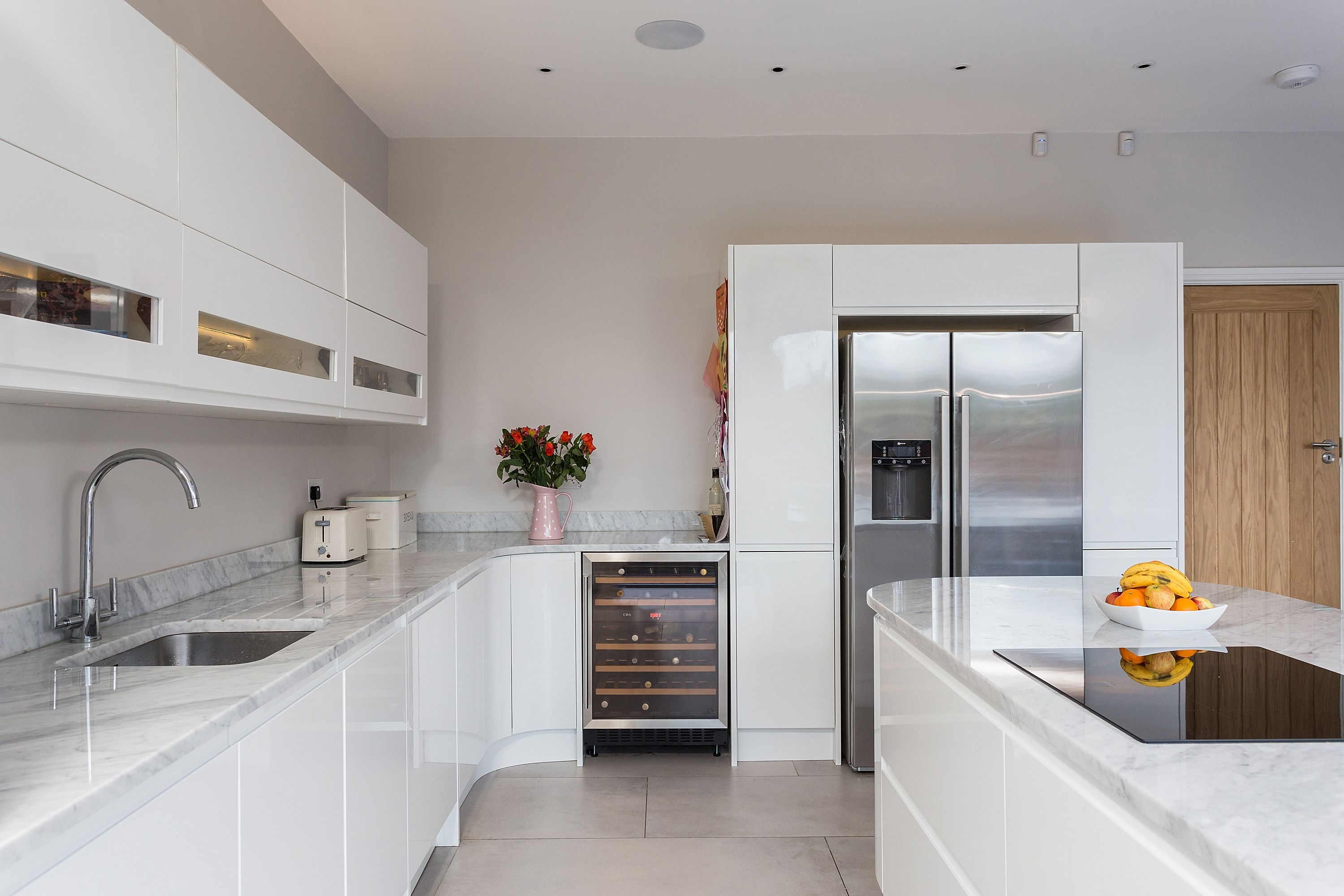 Handleless Gloss White Malmo Kitchen With Island And Carrera Marble Worktops Kitchen Room Design White Gloss Kitchen Ikea Kitchen Design