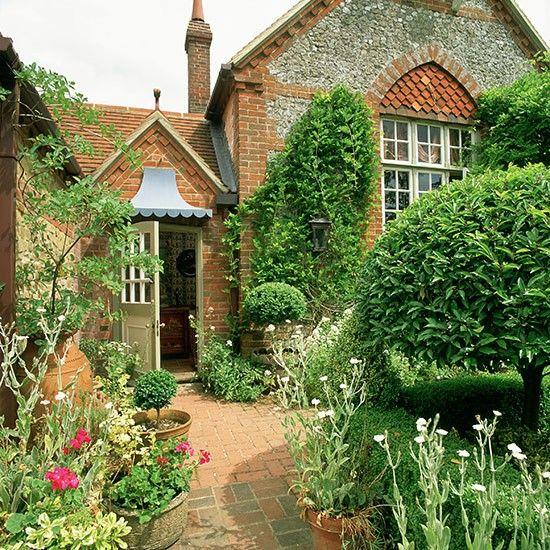 Country front garden with brick paving and pots | Front garden design ideas | Garden | housetohome.co.uk