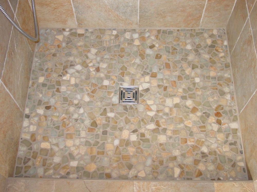 Pebble Shower Floors For Tiled Showers How To Install Small Rocks Tile Your World Shower Tile Shower Floor Pebble Tile Shower