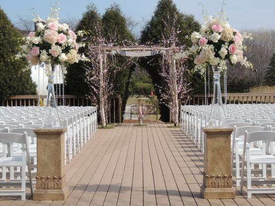 Simple and elegant outdoor wedding ceremony. #wedding #flowers #ceremony #weddingceremonydecor #wedding #ceremony #decor #pillars