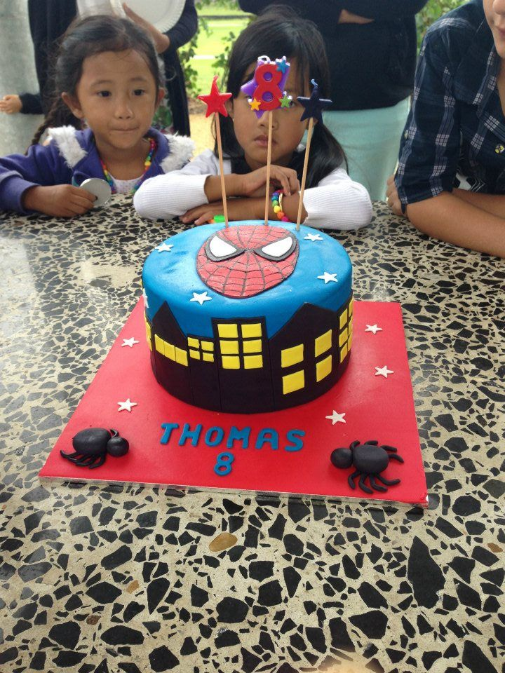 My little brother's 8th birthday cake.  Superman, superheros and very cool
