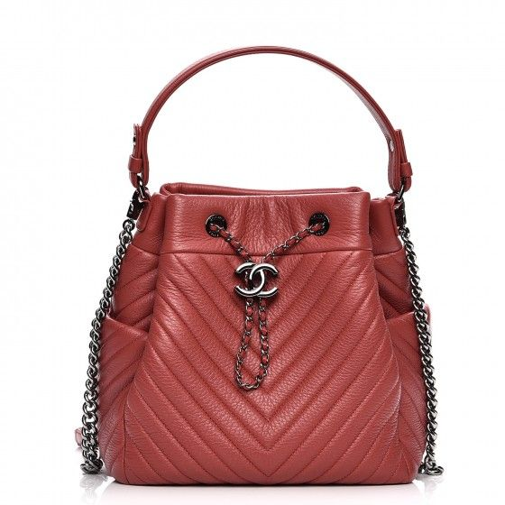 5b505662f60a This is an authentic CHANEL Deerskin Chevron Medium Chain Bucket Bag in  Coral. This stylish shoulder bag is beautifully crafted of chevron quilted  deerskin ...