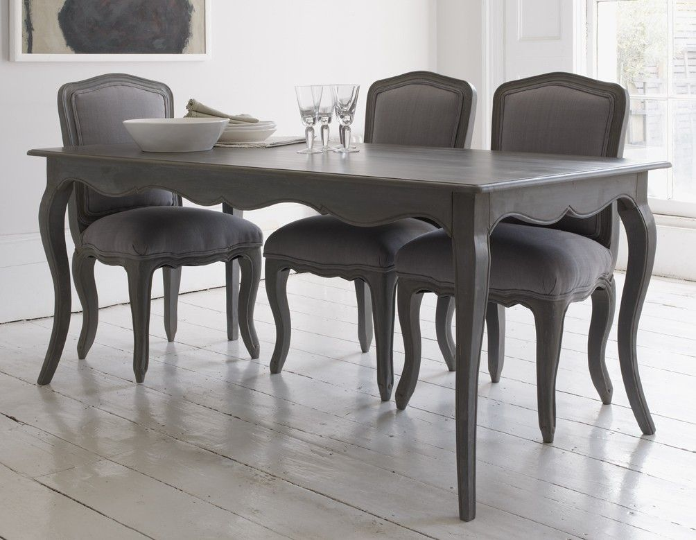Elegant Dining Table With Curved Legs And Attractive Detailing In A Matte Storm Grey Wood Finish