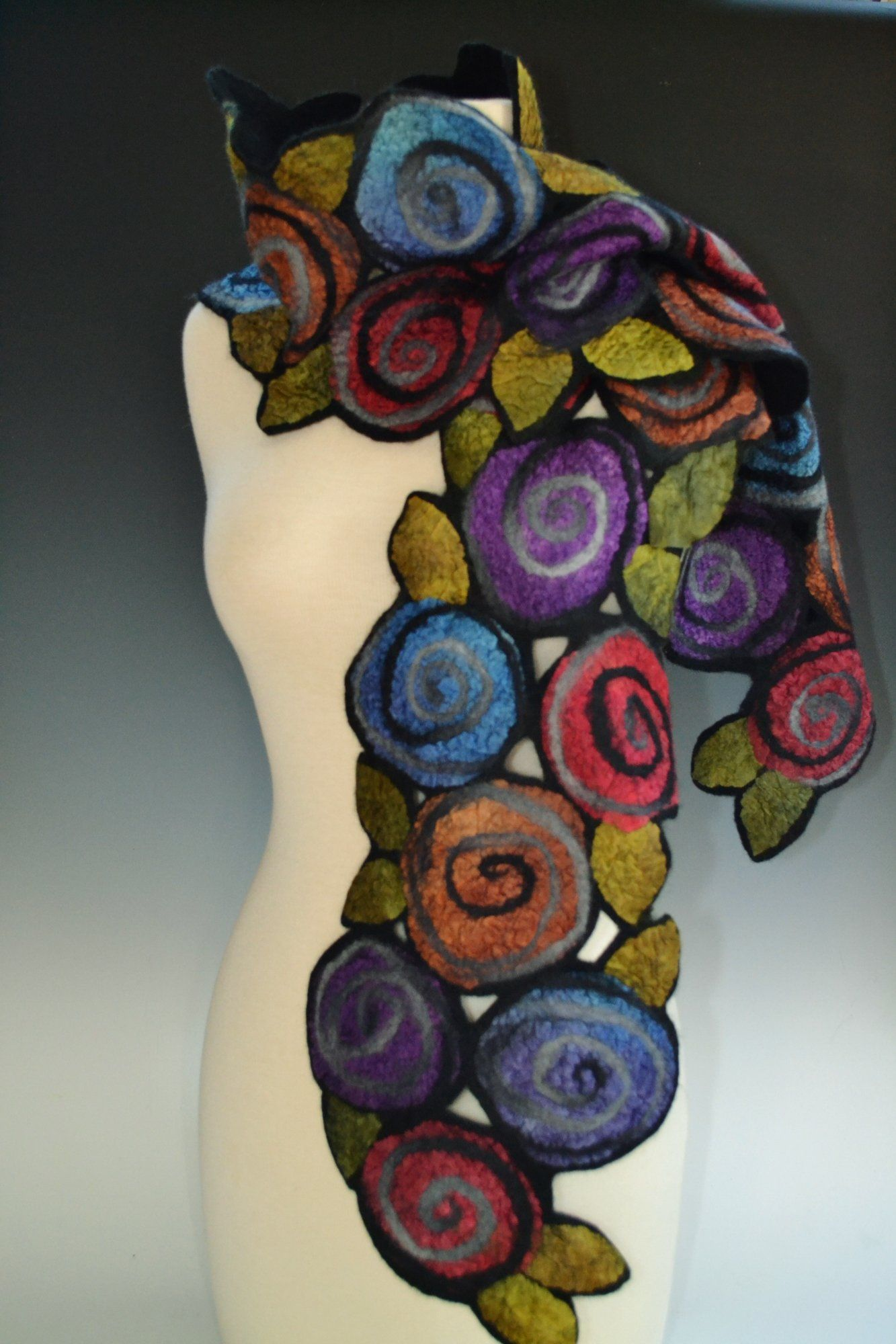 1da996274c4e0 Irene Scarf by Elizabeth Rubidge. Abstract dyed silk fabric roses and  leaves are tossed along a merino wool base. Fine strips of fiber accent and  highlight ...
