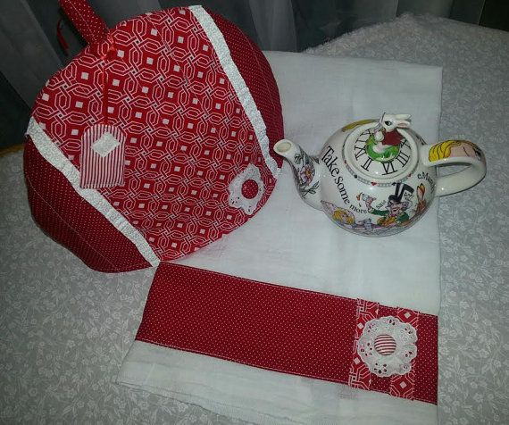 Charming red and white cottage style tea cozy to keep your tea warm during infusing or serving with a darling flower and covered button