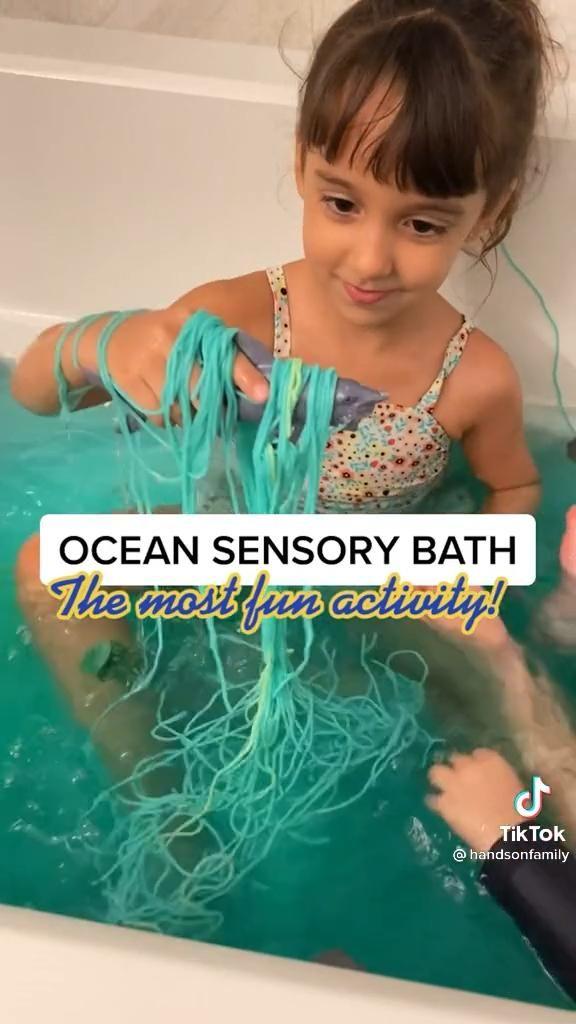 Crazy Cute Sensory Sea Bath Video In 2021 Kids And Parenting Sensory Activities Ocean Fun