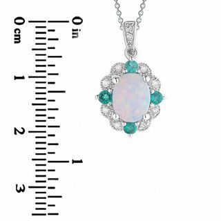 Zales Oval Lab-Created Opal, White Sapphire and Emerald Pendant in Sterling Silver