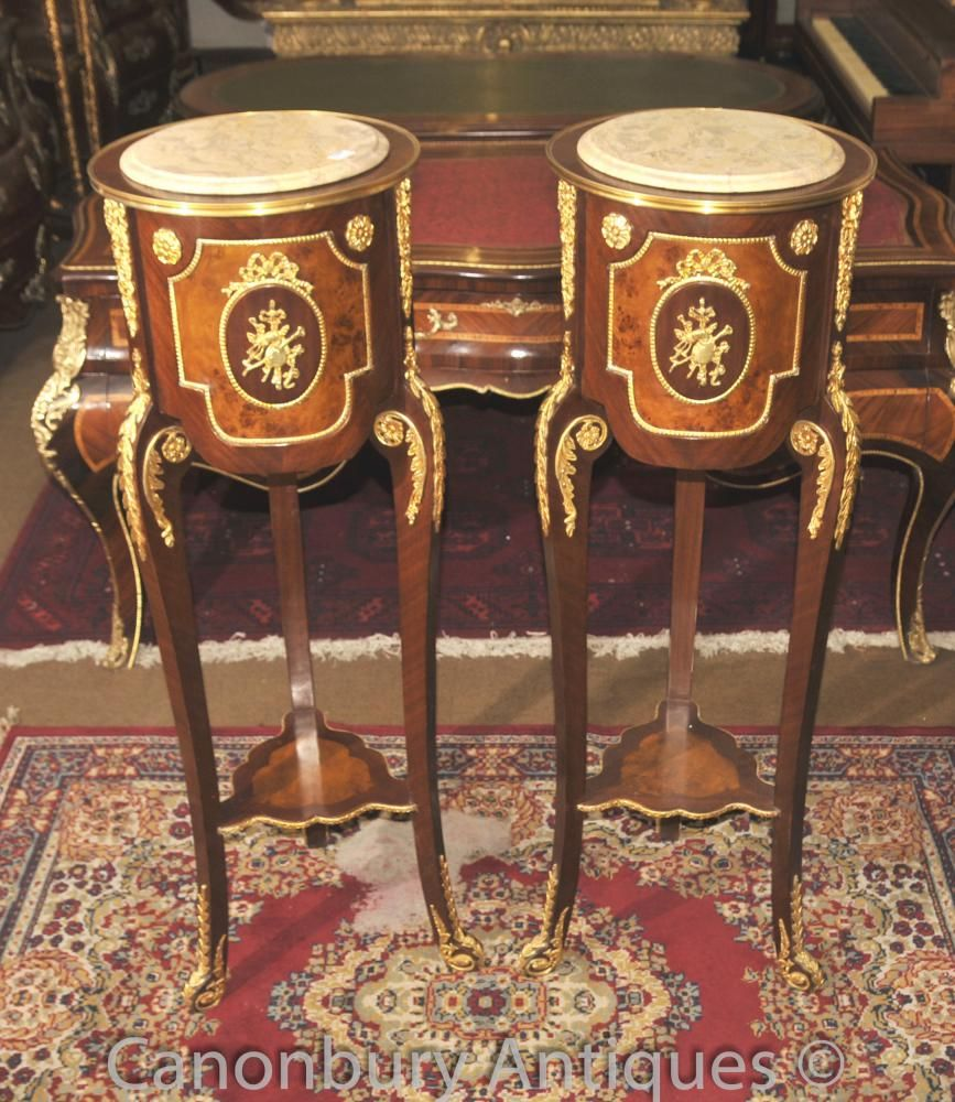 - Elegant and refined pair of French Empire style side tables <br /> - Made from kingwood for main structure with walnut panels<br /> - Ormolu fixtures are bright and well cast and original to tables<br /> - Tall so these are great for displaying decorative pieces such as porcelain urns and statues<br /> - We have a whole range of other French Empire style furniture and tables, so let us know what you're looking for<br /> - Purchased from a dealer on Marche Dauphine at the Paris antiques…