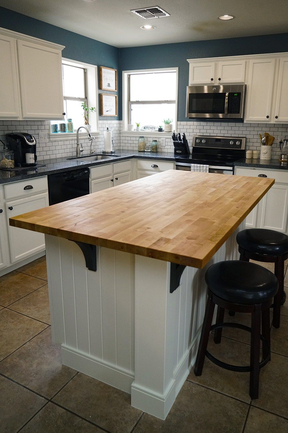 This kitchen island is so unique! I love the paneling on ...