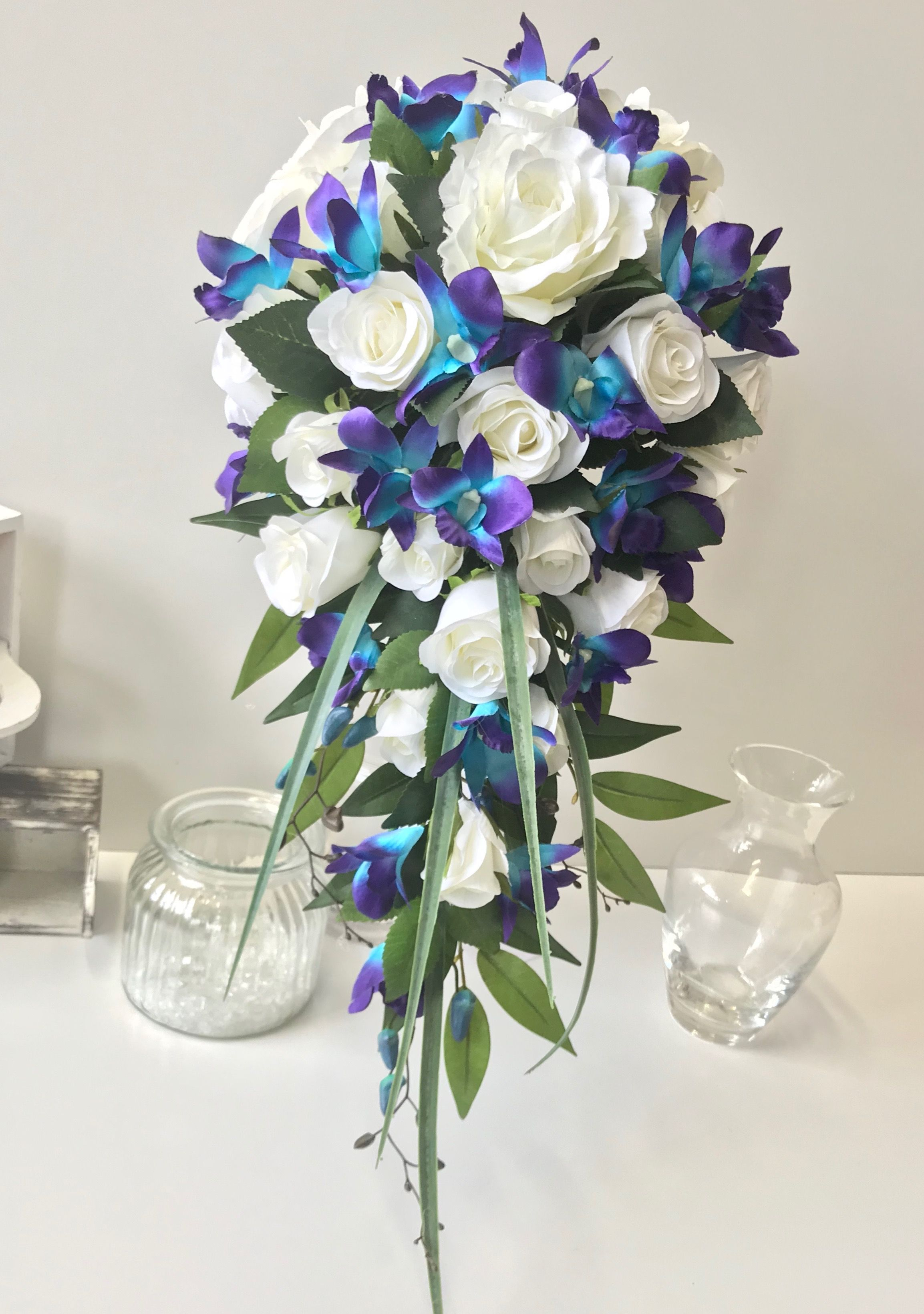 Wedding bouquets teardrop  White rose galaxy blue purple orchids teardrop  Blue wedding