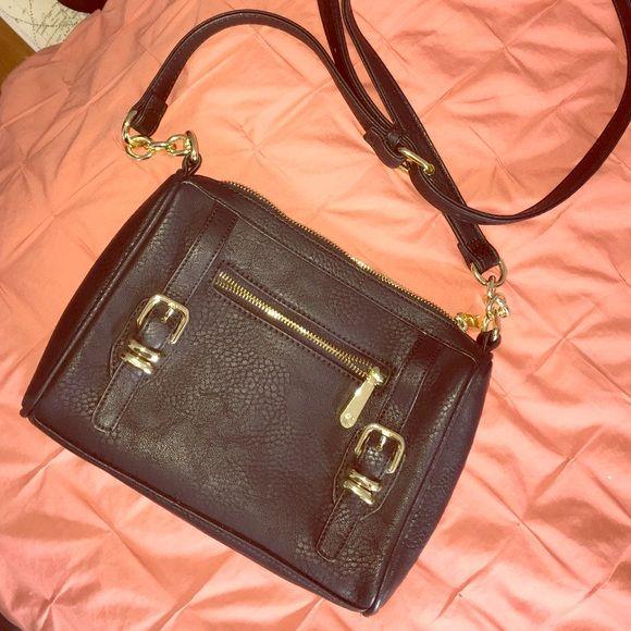 NWOT Charming Charlie Crossbody ✨ Black and gold / never used / adjustable strap / super adorable Charming Charlie Bags Crossbody Bags