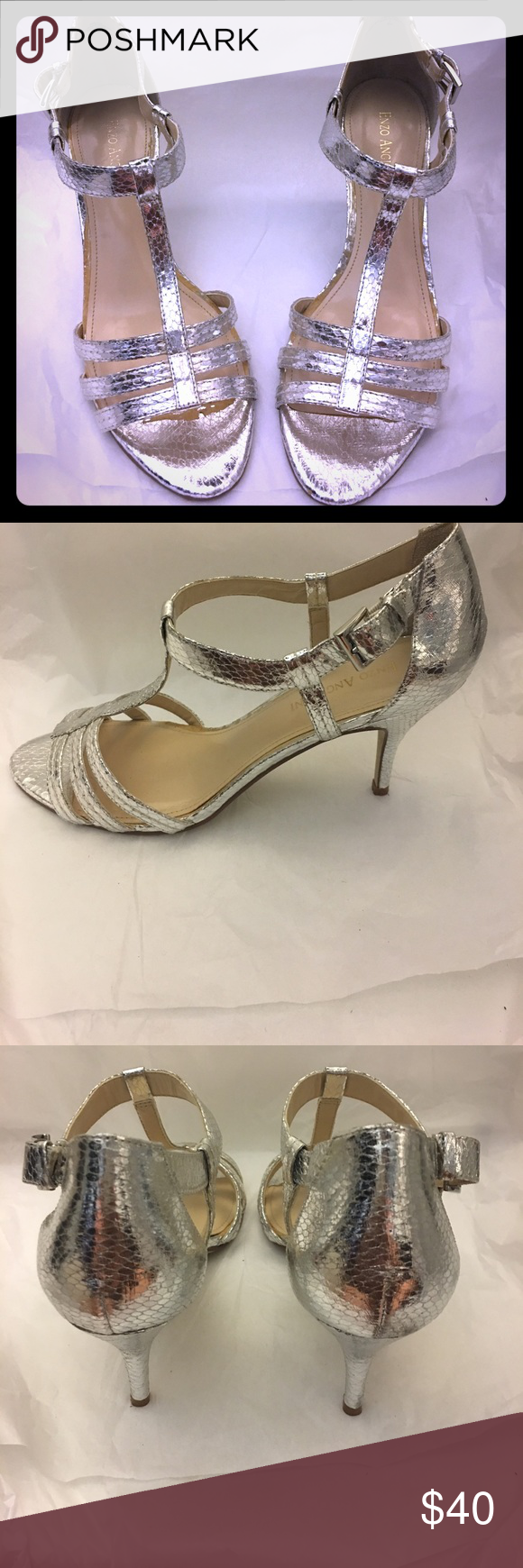 Women's Enzo Angiolini Silver Heels Size 8 Women's Enzo Angiolini Silver Heels that Fasten at the Ankle 3 inch heels -Some Fading on inside of Right Shoe (as shown) . Otherwise , great buy worn one time. Pair it with one of the  gowns in my closet ! Enzo Angiolini Shoes Heels