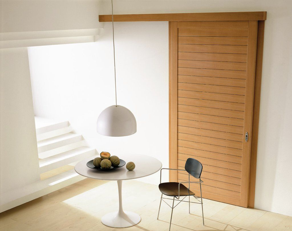 Modern interior sliding door featuring cherry inlaid panel with