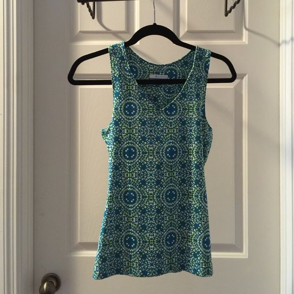 Omani-wick Columbia Sportswear built in bra tank Teal, yellow, white workout built in bra sleeveless tank top. Looks look! V-neck size small Columbia Tops Tank Tops
