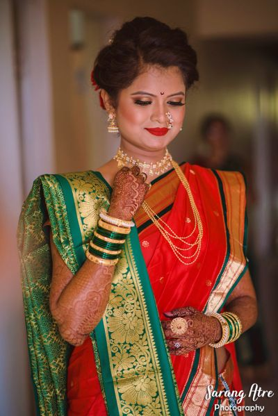 02e2b882e1fc2 South Indian Bride - Green and Red Saree with Gold Detailing