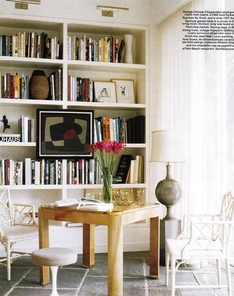 white faux bamboo chairs & built-in bookcase