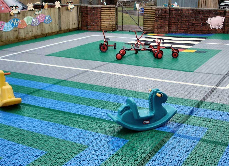 Outdoor play area flooring flooring designs royal are interlocking free draining floor tiles for indoor dailygadgetfo Images