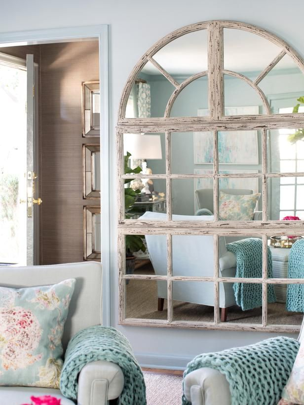 Oversized Mirror In 13 Ways To Make A Small Living Room Look Bigger From HGTV