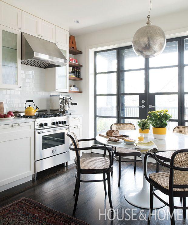 Designer Mazen El-Abdallah creates an airy vibe in his kitchen with a white backsplash and cabinets.   Photographer:  Alex Lukey  Designer:  Mazen El-Abdallah