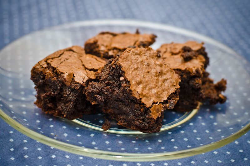 Brownies take a hint of Triple Sec for added flavor. Made with almond meal, they are flourless and gluten-free.
