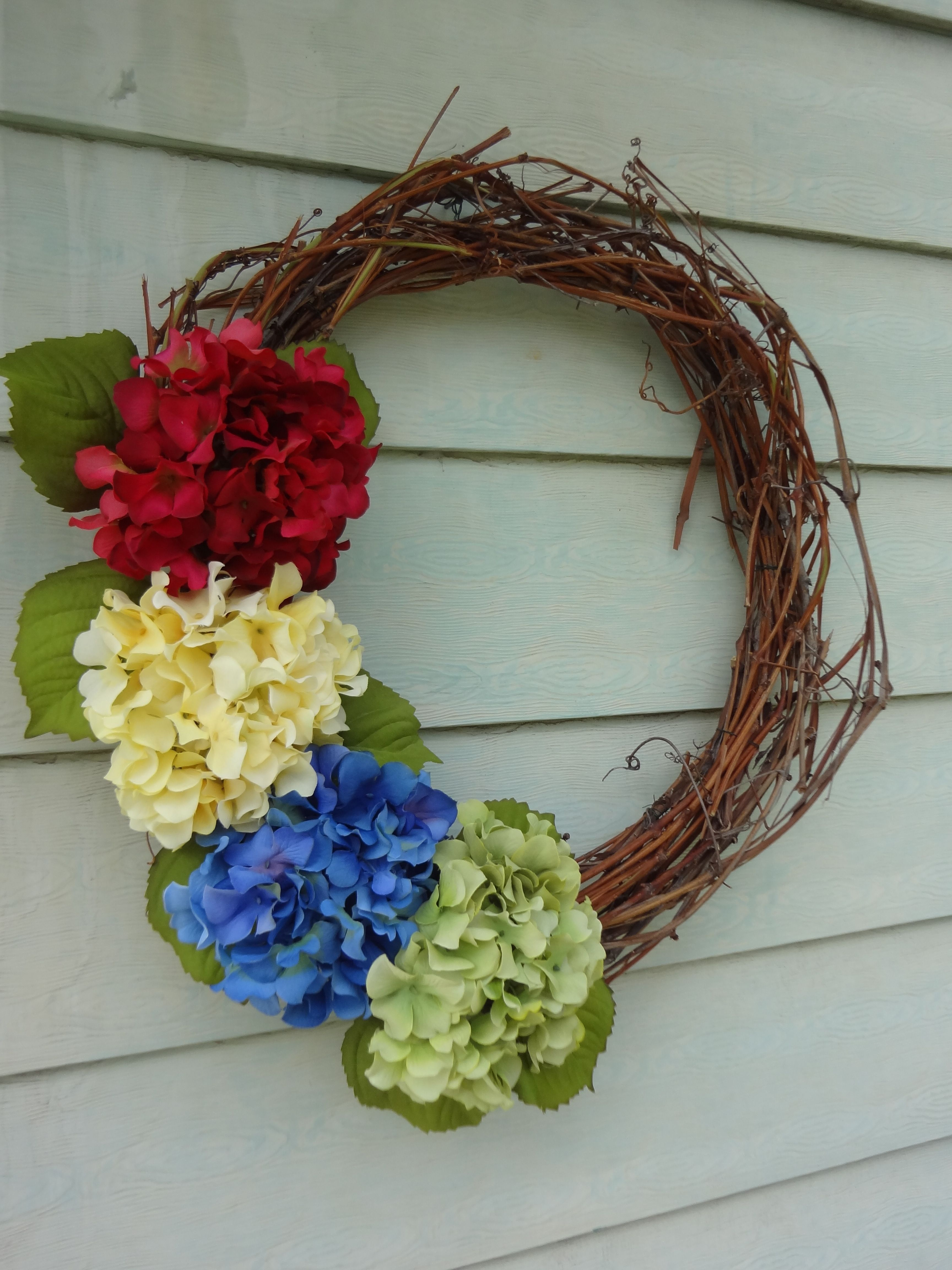 Grapevine wreath with flowers a little color for