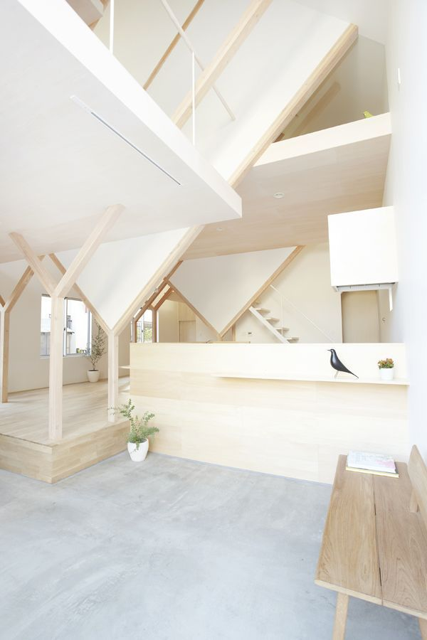 bright modern interior with concrete floors and wooden beams ...