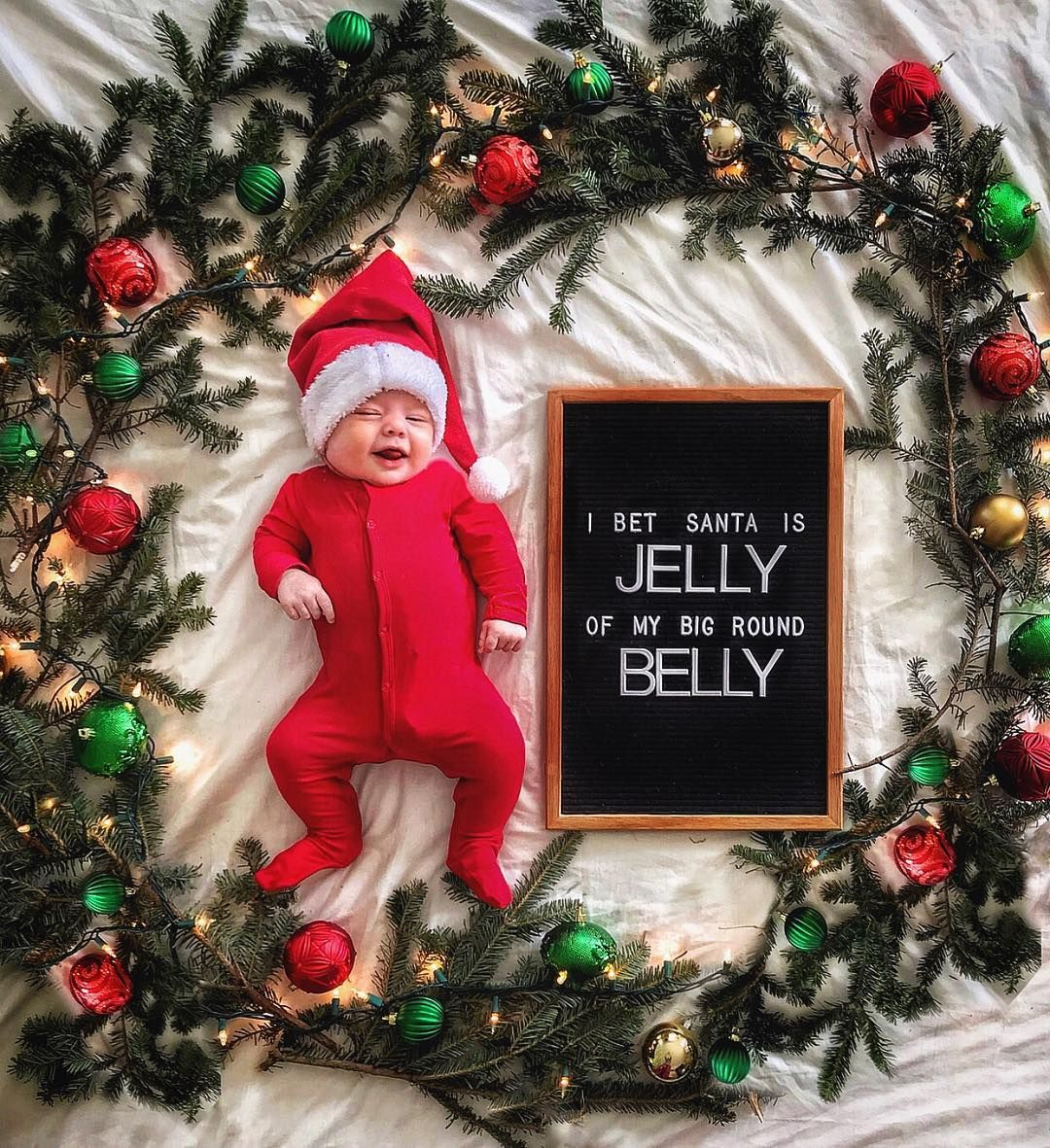 The 13 Funny Christmas Letter Board Quotes We Can T Wait To Use Baby Christmas Photos Christmas Baby Pictures Baby Christmas Photography