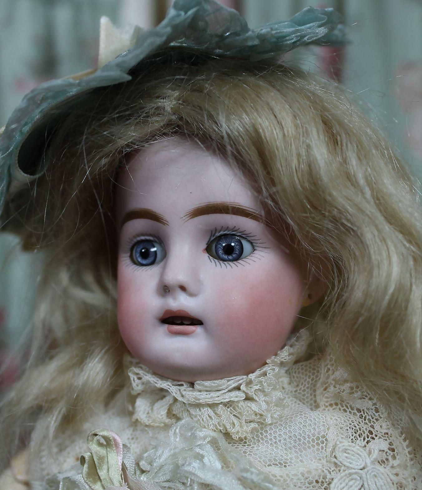 This gem of a cabinet size doll is too adorable for words and she comes with her antique trunk filled with antique clothes and rare antique fur