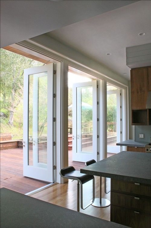 Doors Off Kitchen Breakfast Area Just Opening Up To Outside Left