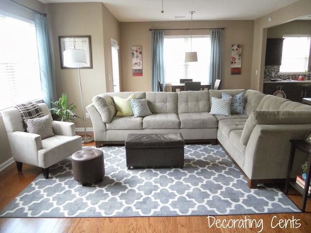 Family room gray trellis rug sectional blue accents for Rug under sectional sofa