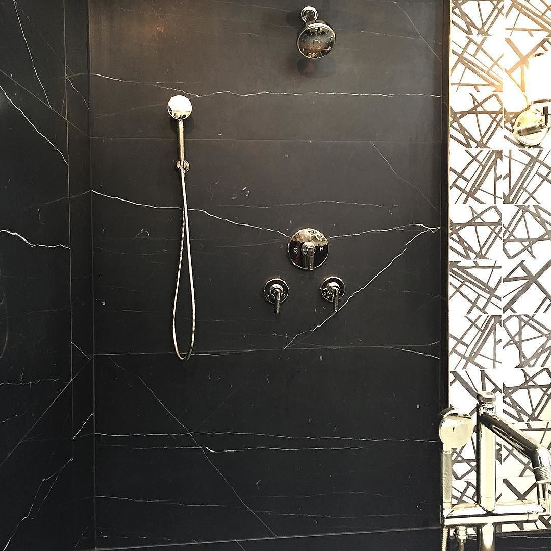 Black Marble Shower Combined With Black And White Graphic Tiles