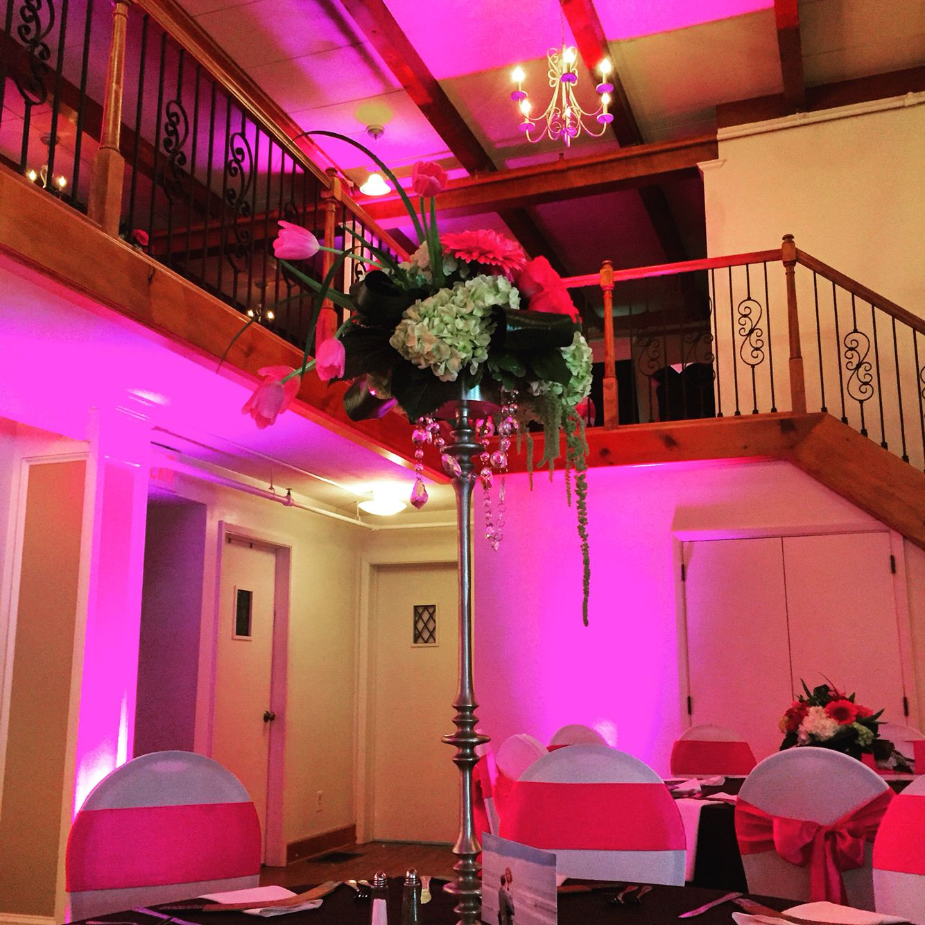 Talk centerpieces from Wisteria and pink uplighting