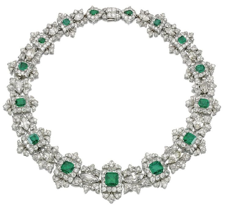 AN IMPORTANT EMERALD AND DIAMOND NECKLACE, CARTIER.  Designed as a graduated series of step-cut emeralds within scalloped frames of circular- and single-cut diamonds interspersed with foliate links each centring on a navette-shaped diamond, signed Cartier Paris made in France and numbered, French assay and maker's marks, length approximately 410mm detachable into three sections of approximately 225mm, 90mm and 80mm respectively, fitted case by CARTIER LONDON.