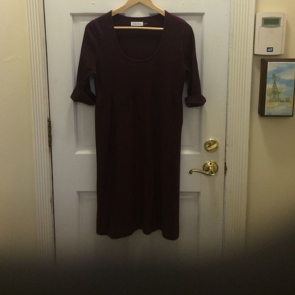 Calvin Klein knit dress in Burgundy. Knit scoop neck, some what low in size large. Calvin Klein Dresses Midi