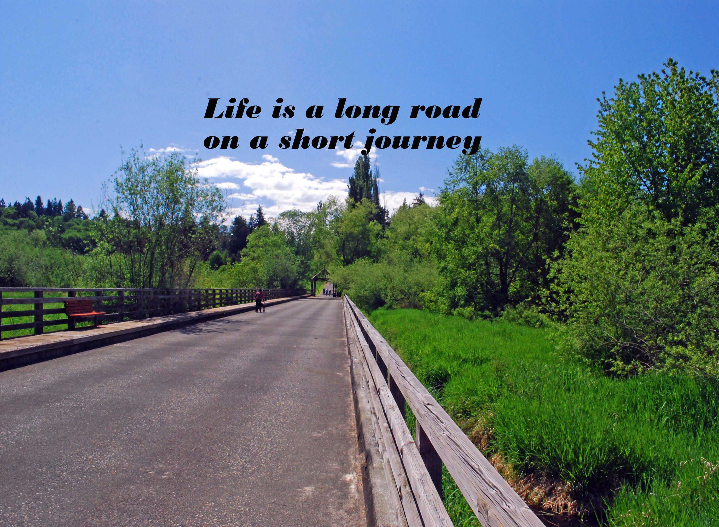 photo of a road under a bright sunny blue sky a life quote