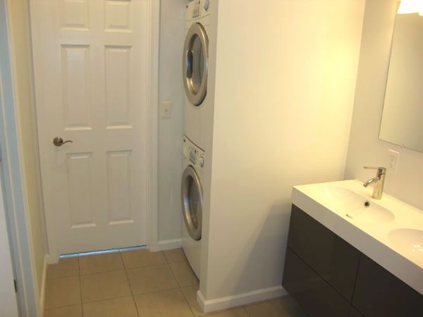 Upper level bathroom with area for stackable washer and ...