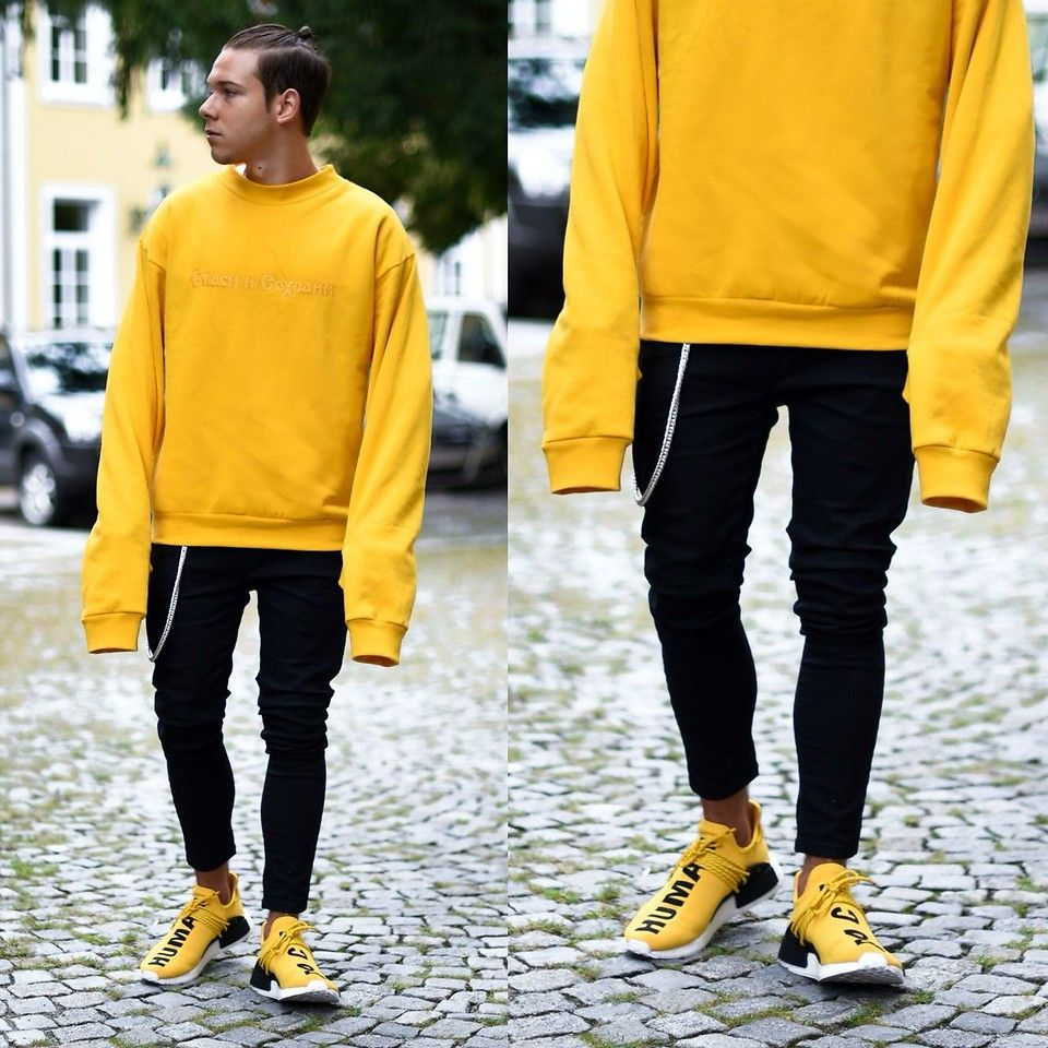 Today Im Wearing A Sweater With Extra Long Sleeves By @gosharubchinskiy, Black Pants By @bershkacollection, Jean Chain By @chainedandable And Shoes By @adidasoriginals X Pharrell NMD Human Race. Bless Up :)  Follow Me On Instagram As Well https://www.instagram.com/achmedlachned/  #gosharubchinskiy #bershka #adidasoriginals #nmd #humanrace #outfit #streetstyle #longsleeves #men #fashion #yellow #vienna #menswear #simple #minimal #chainedandable #austria